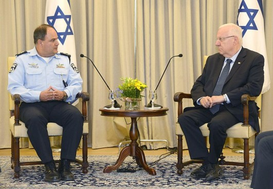 Bentzi Sau (left), meeting with President Reuven Rivlin as Acting Chief of the Israeli Police, on 13 July 2015. In 2003, the Or Commission found Sau to be responsible for the police's use of lethal tactics, including live sniper fire, against demonstrations by Palestinian citizens of Israel during the events of October 2000, which killed 13 people. Photo from Wikimedia Commons.