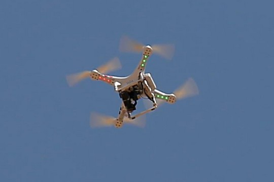 An IDF drone hovers above the West Bank village of Bil'in. (photo: Haitham Khatib)