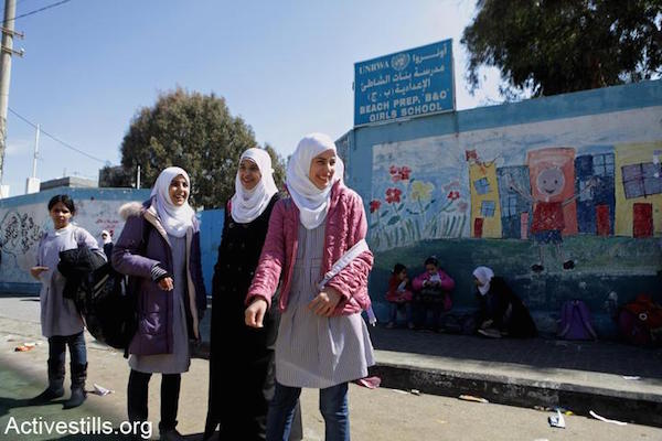 Young school girls standing in the foreground of the UNRWA-run all-girls' school. Ash Shati Refugee Camp, Gaza Strip, February 25, 2012. (Anne Paq/Activestills)