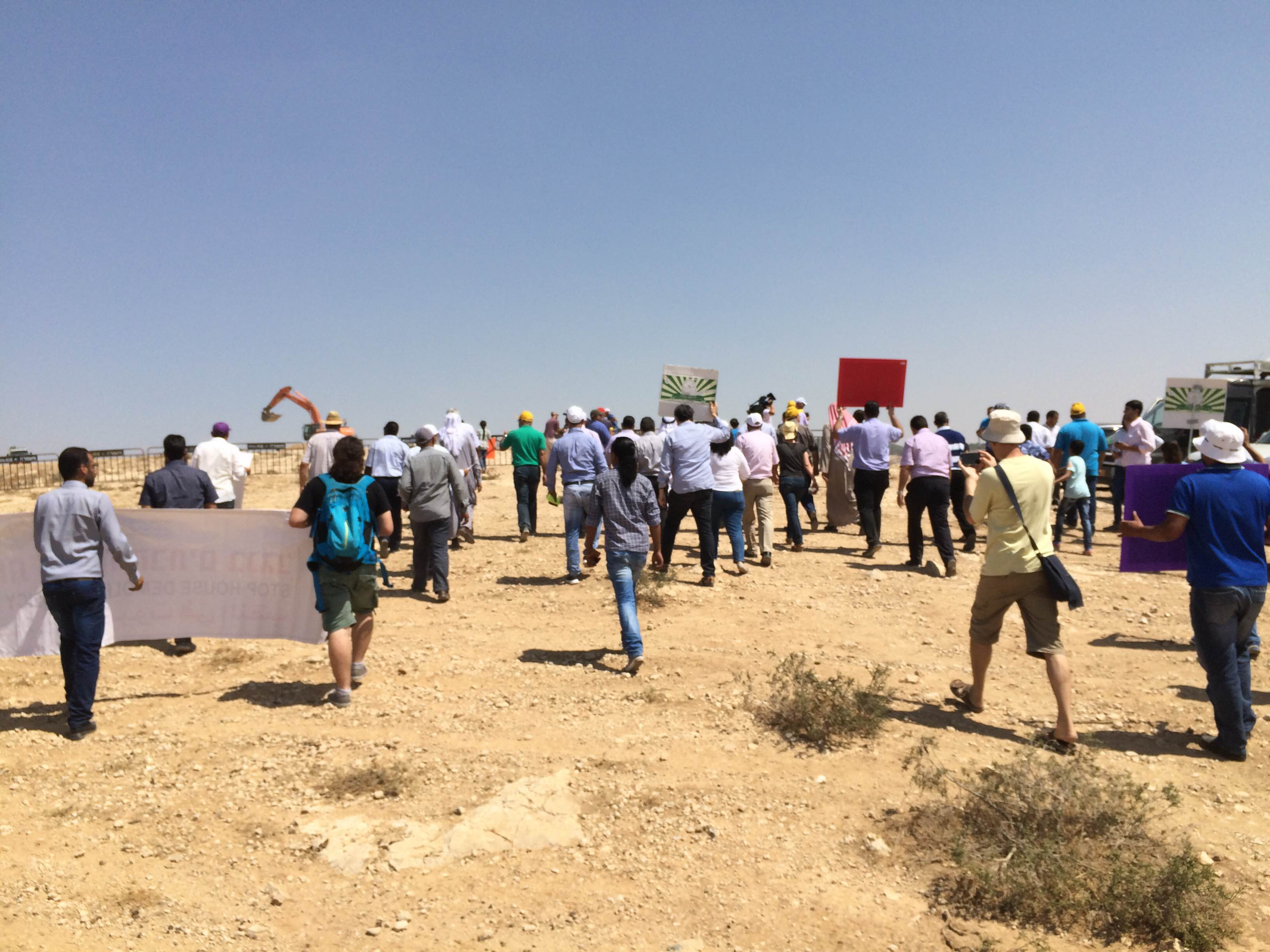 Protesters march as construction begins for Jewish town to replace Bedouin village. August 27, 2015 (Amjad Iraqi / Adalah)