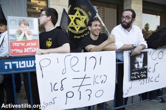 "Lehava members protest in front of Jerusalem gay pride parade, holding signs with slogans such as ""Jerusalem is not Sodom."" July 30, 2015. (Keren Manor/Activestills)"
