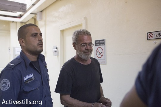 Israeli artist David Reeb seen as he is brought before a judge at the Jerusalem Magistrates Court, August 22, 2015. (photo: Oren Ziv/Activestills.org)