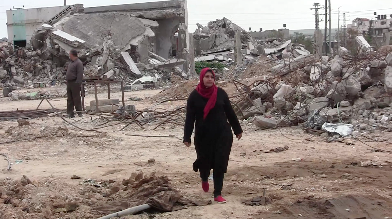Sabreen Al Tartor, field worker for PCHR, in the rubble of Shejaiya, eastern Gaza City.