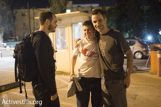 B'Tselem Spokesperson Sarit Michaeli (center) is seen after a judge ordered her release from detention without conditions, August 21, 2015. (photo: Oren Ziv/Activestills.org)