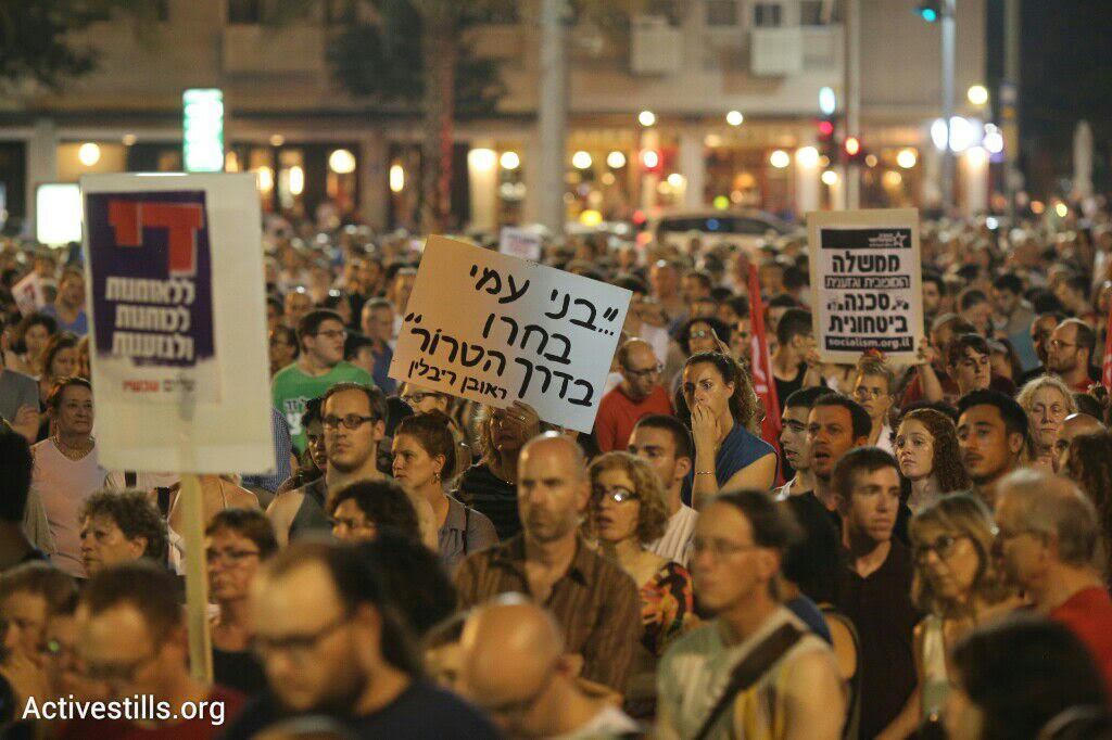 Thousands attend a rally organized by Peace Now protesting the arson attack that took the life of an 18-month-old Palestinian baby, Rabin Square, Tel Aviv, August 1, 2015. (photo: Oren Ziv/Activestills.org)