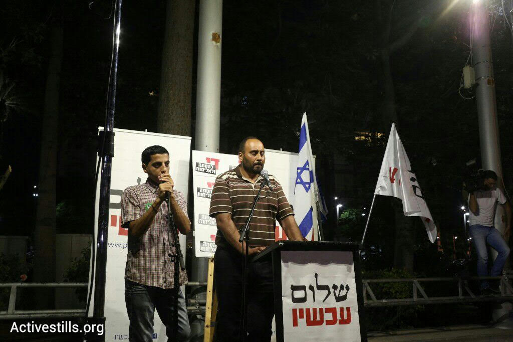 Nasser Dawabshe, uncle of 18-month-old Ali Dawabshe, who was burned alive during an arson attack this week,  speaks during the Peace Now rally, August 1, 2015. (photo: Oren Ziv/Activestills.org)