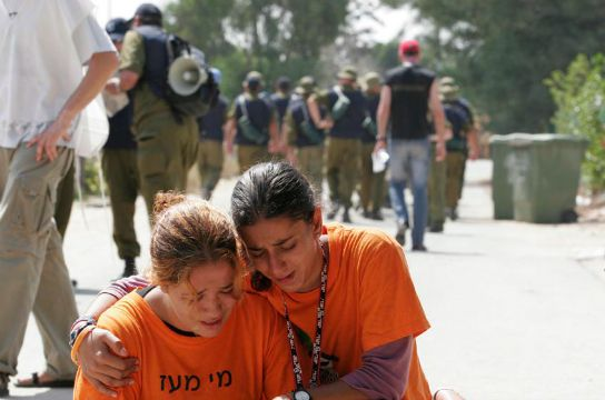 Girls crying at the evacuation of a settlement in Gaza, August 2015 (IDF Spokesperson)