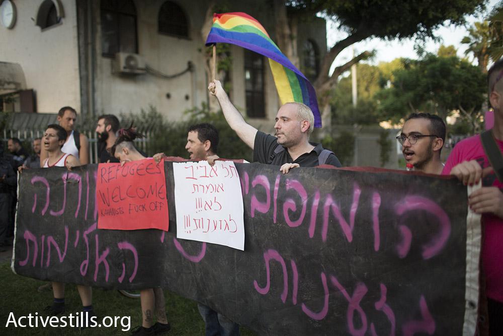 LGBT activist counter protest at far-right demonstration in south Tel Aviv. August 19, 2015. (Activestills)