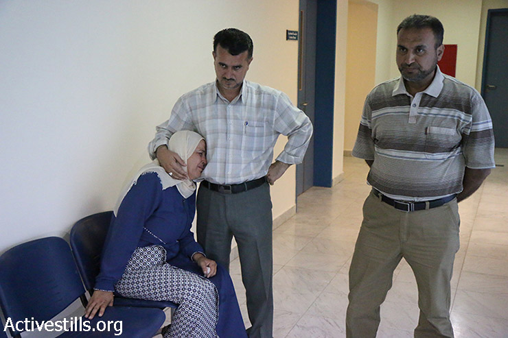 Family of Mohammed Amsheh, 22, who was shot to death by Israeli forces, mourns their son at the Forensic Medical Center of Nablus, West Bank, August 17, 2015.Israeli armyspokespersonalleged that the man attempted to stab an Israeli officer near Nablus, while Palestinians denied, saying that he was killed in cold blood. Less than 48-hours ago, Israeli forces had killed another 21 year-old Palestinian near Nablus under the same pretext. Tensions have soared in the West Bank in recent weeks in the wake of the deadly firebombing of a Palestinian home, attributed to Israeli extremists. (photo: Oren Ziv / Activestills.org)