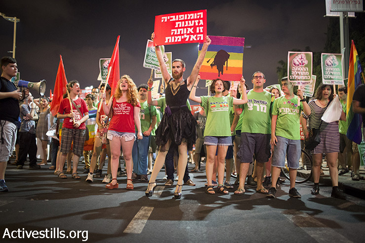 Israeli left-wing activists protest against recent Jewish violent attacks on the Dawabsha family and LGTBQ activists, Tel Aviv, August, 8, 2015. The activists called slogans against government incitement against Palestinians and the LGTBQ community, as well as other ethnic minorities. (photo: Oren Ziv / Activestills.org)