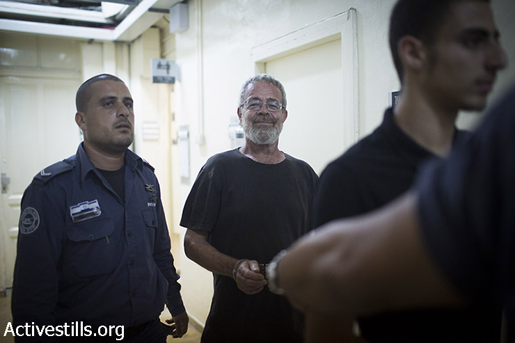 Artist David Reeb is seen before his hearing in the Jerusalem court, August 22, 2015. The Israeli army arrested on Friday Sarit Michaeli, David Reeb and Bilal Tamimi, while they were documenting the weekly protest in the West Bank village of Nabi Saleh. The soldiers claimed it was a closed military zone, but refused to show the order. The Jerusalem court ordered to release Sarit and David with no conditions. Bilal was released on Sunday morning from the Ofer Military Prison. (photo: Oren Ziv / Activestills.org)