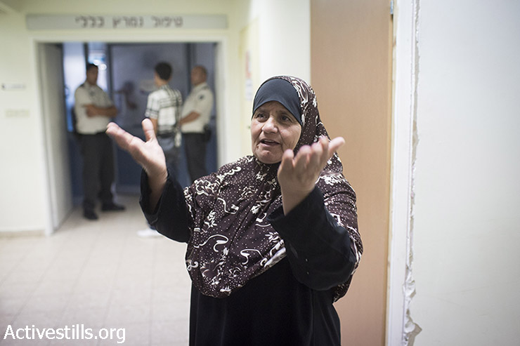 Maazouze, the mother of Palestinian prisoner, Mohammed Allan, who is on a long-term hunger strike, waits outside his room at the Barzilai Medical Center in the city of Ashkelon, on August 18, 2015. 31-year-old Allan  declared in front of his doctors that if there is not any solution to his case within 24 hours he will ask for all treatment to stop and will stop drinking water, the Palestinian Prisoners Club said in a statement. (photo: Oren Ziv / Activestills.org)