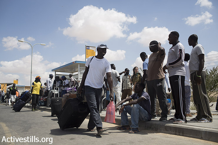 African Asylum Seekers leave the Holot detention centre after their release in Israel's southern Negev desert August 25, 2015. Israel began releasing some 1,200 African Asylum Seekers whom it has interned for more than a year in the detention centre. Under the terms of their release, they are banned from living or working in Tel Aviv and the southern resort city of Eilat, which both have large African Asylum Seekers communities. (photo: Oren Ziv / Activestills.org)