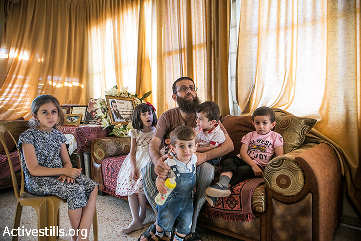 Khader Adnan a Palestinian prisoner who staged a 56-day hunger strike while being detained for a year without charge by Israeli authorities, seen with his family in the West Bank village of Arraba  on Augost 12, 2015. Adnan, 37, was detained a year ago, shortly after the kidnapping and murder of three young Israelis, which triggered the arrests of hundreds of Palestinians in the occupied West Bank. (Ahmad al-Bazz / Activestills.org)