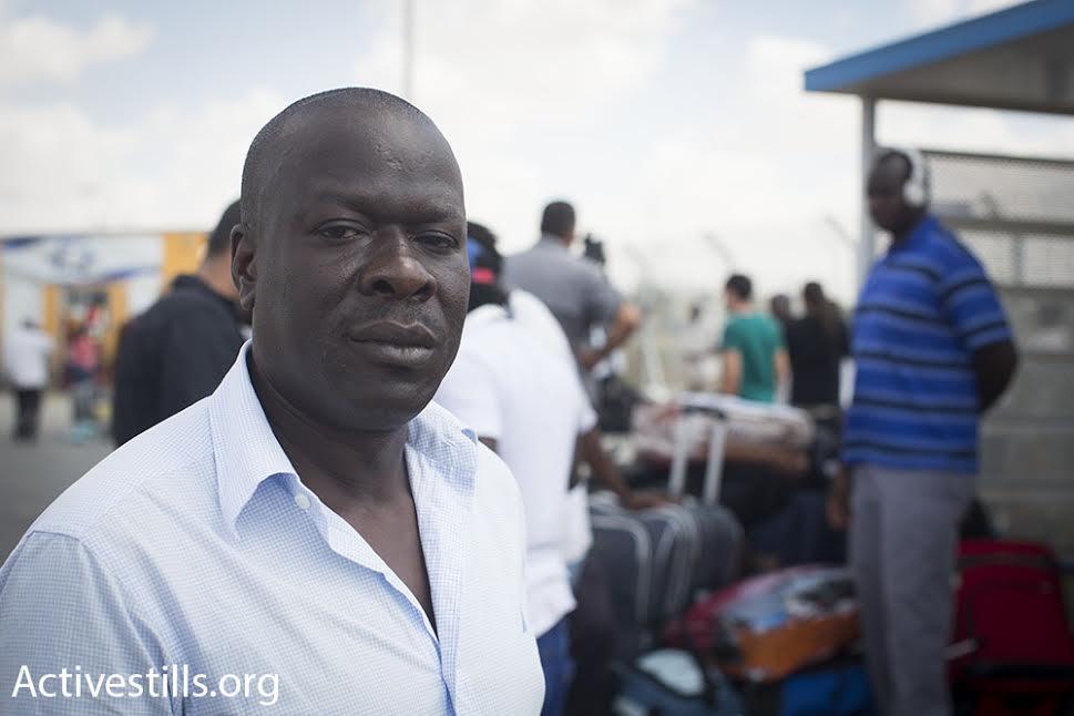 An asylum seeker stands outside Holot detention center after being released, August 25, 2015. (photo: Oren Ziv/Activestills.org)
