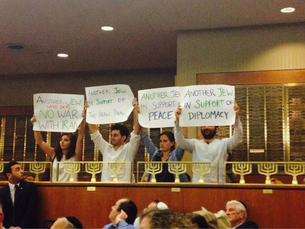Activists held up signs in support of Iran deal at a Brooklyn town hall meeting with Democratic Congressman Hakeem Jeffries. August 11, 2015. (Twitter)