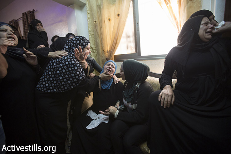 The mother of Palestinian youth Mohammed Sami al-Ksbeh, 17, mourns during his funeral in Qalandiya refugee camp, near the West Bank city of Ramallah July 3, 2015. A senior Israeli army officer shot and killed Ksbeh who was throwing stones near a checkpoint in the occupied West Bank on Friday. (photo: Fiaz Abu-Rmeleh / Activestills.org)
