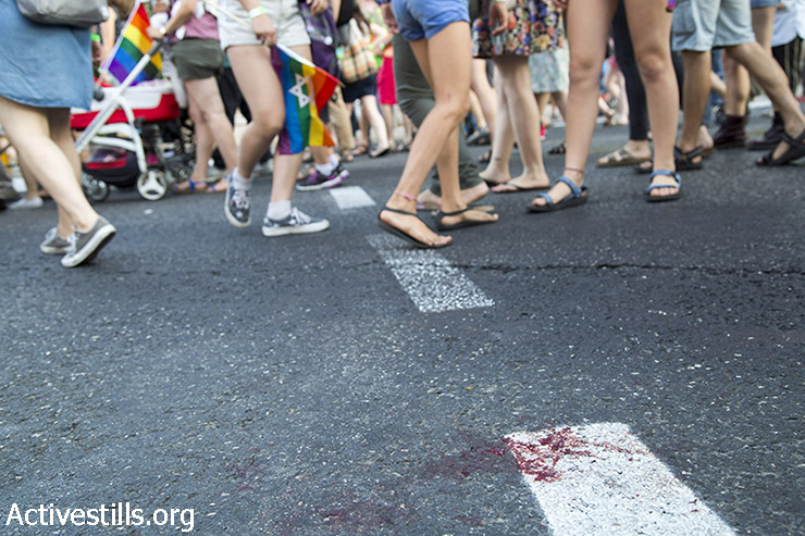Blood is seen on the pavement following a mass stabbing attack against the Jerusalem LGBTQ Pride Parade in Jerusalem, July 30, 2015. Six people were stabbed at Jerusalem's annual Gay Pride Parade. The suspected attacker, Yishai Schlissel, is the same man behind the attack on the 2005 parade, recently released from 10 years in prison. (photo: Keren Manor / Activestills.org)