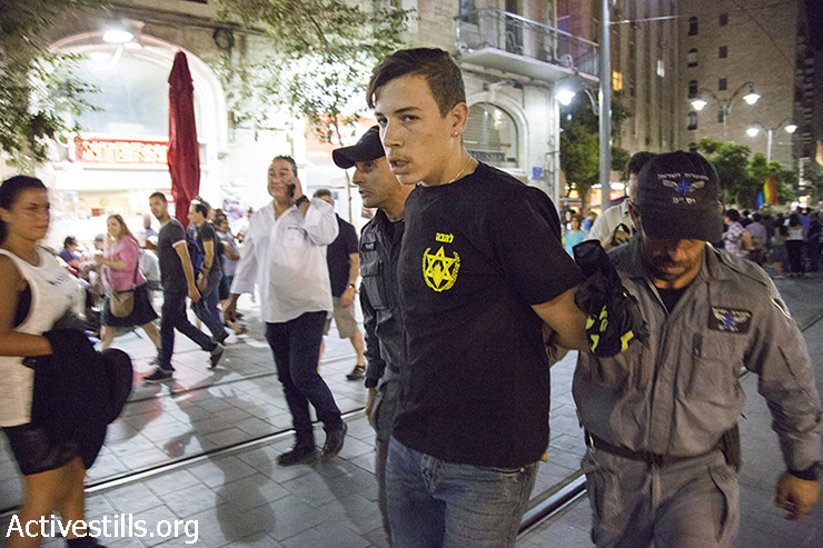 Right wing activist is being arrested during a LGBTQ rage demonstration against the stabbing attack during the Jerusalem Pride Parade just several hours before, July 30, 2015. Six people were stabbed at Jerusalem's annual Gay Pride Parade. The suspected attacker, Yishai Schlissel, is the same man behind the attack on the 2005 parade, recently released from 10 years in prison. (photo: Keren Manor / Activestills.org)