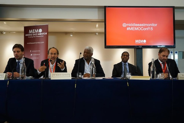 Bolivia's ambassador to the United Kingdom Roberto Sarmiento speaks during a panel at the 'Palestine & Latin America in the 21st Century' conference. Left to right: Ecuador's Minister of Culture Guillaume Long, Sarimiento, Islam Channel's Director of Int'l Operations Carl Arrindell, Councillor of the Cuban Embassy, and editorial director of Huffington Post Arabi Wadah Khanfar. (photo: Middle East Monitor)