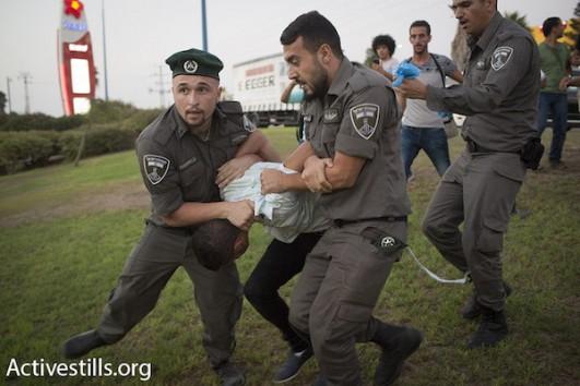 Israeli police detains a Palestinian protester at a demonstration for the release of hunger striker Mohammad Allan, outside of Barzilai hospital in Ashkelon, Israel. (Oren Ziv/Activestills.org)