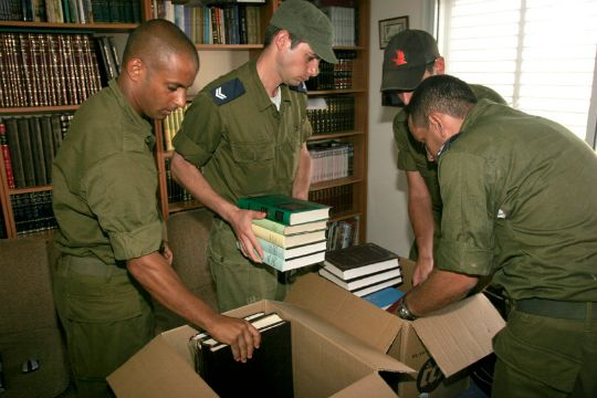 Soldiers pack up the belongings of settlers evacuated from Gaza (IDF Spokesperson)