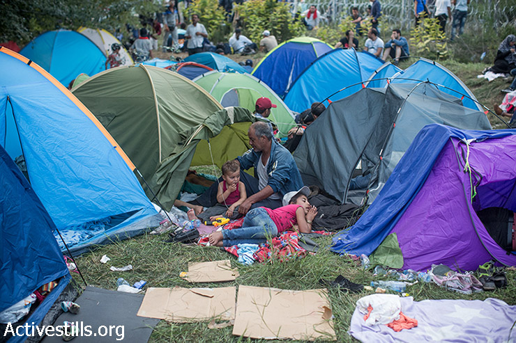 Refugees, some of them from Syria, camp in front of the closed Serbian-Hungarian border, September 15, 2015.