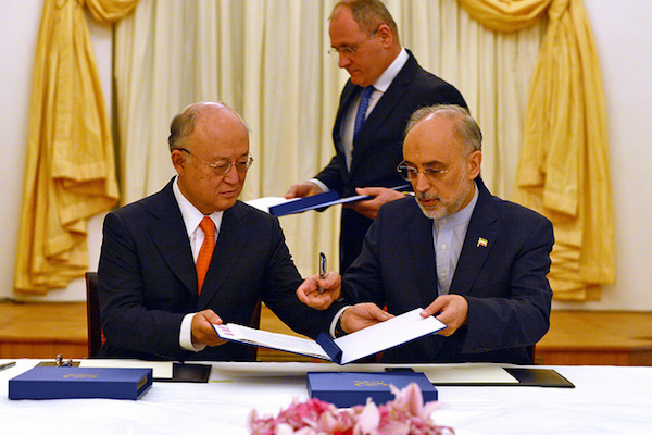 IAEA Director General Yukiya Amano and Vice President of the Islamic Republic of Iran Ali Akhbar Salehi at the signing of a roadmap for the clarification of past and present issues regarding Iran's nuclear program in Vienna. Coburg Palace, Vienna, Austria, 14 July 2015. (Photo: Dean Calma / IAEA)