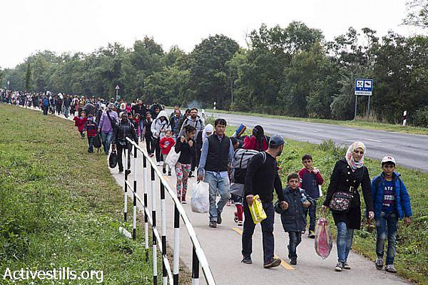 Refugees march toward the Hungarian-Austrian border. (Keren Manor/Activestills.org)