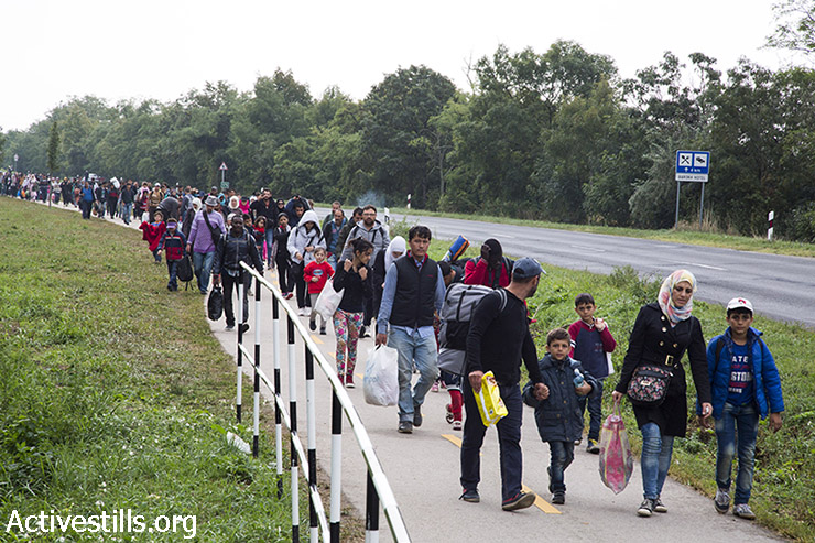 Refugees march toward the Hungarian-Austrian border. (Keren Manor/Activestills.org)