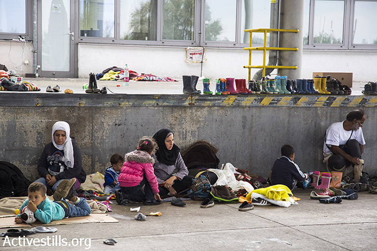Women and children rest at the transit camp on the Austrian border. In the past the area was a border terminal but has not been used since border restrictions were abolished within the European Union's Schengen zone. (Keren Manor/Activestills.org)