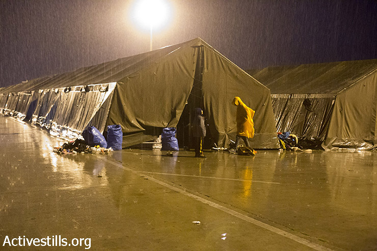 Army tents brought in to provide shelter flooded in the rain. (Keren Manor/Activestills.org)