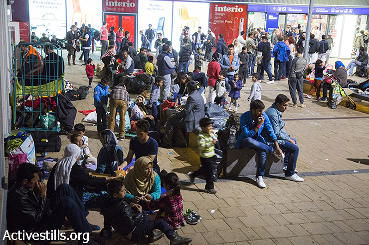 Refugees at the train station in Vienna. (Keren Manor/Activestills.org)