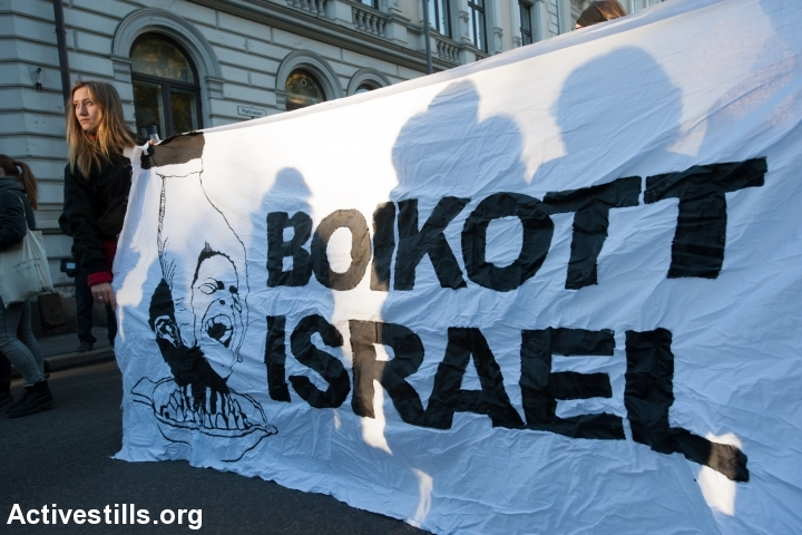"Activists hold a banner reading ""Boycott Israel"" during a protest in solidarity with Palestine near the Israeli embassy in Oslo, Norway, October 17, 2015. The protest was part of a global wave of demonstrations in solidarity with Palestine. (photo: Ryan Rodrick Beiler/Activestills.org)"