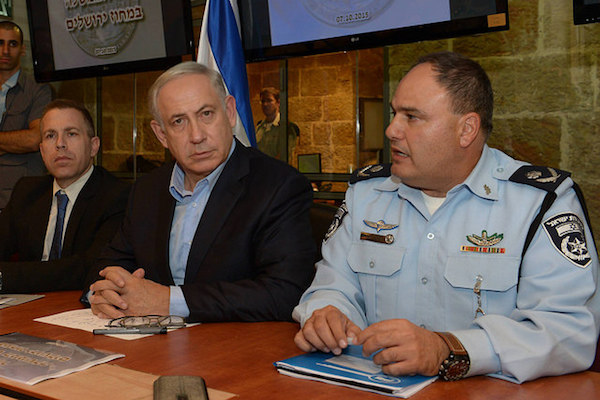 Prime Minister Benjamin Netanyahu attends a situational security briefing at Jerusalem Police Headquarters amid growing unrest, October 7, 2015. (Amos Ben-Gershom/GPO)