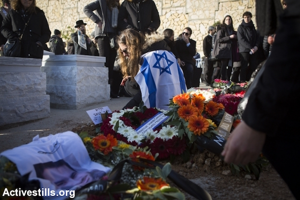 File photo of Jewish Israelis mourning at a funeral for murder victims. (Oren Ziv/Activestills.org)