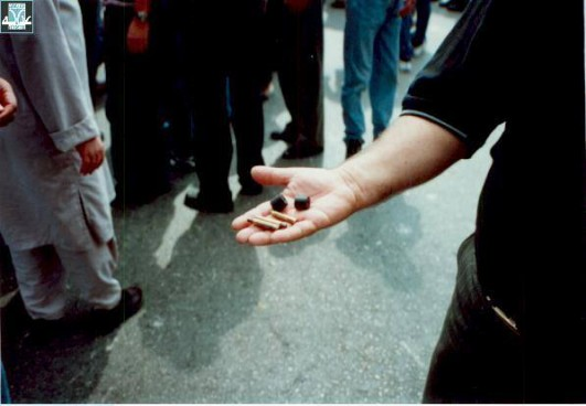 A man holds out bullets used by the Israeli police against demonstrators in early October 2000. Photo courtesy of Adalah.