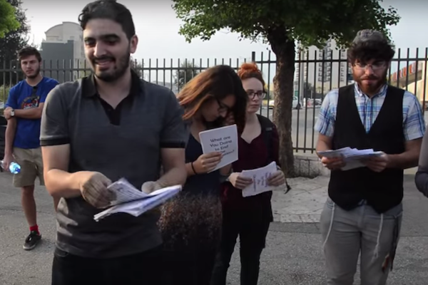 Jewish anti-occupation activists hand out flyers to delegates at the World Zionist Congress, Jerusalem, October 20, 2015. (photo: Laura Gottesdiener)