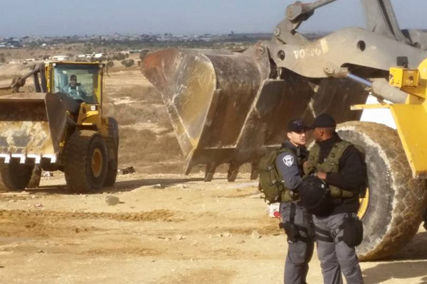 Two bulldozers and two police officers was all it took, Al Araqib, October 28, 2015. (Aziz Alturi)