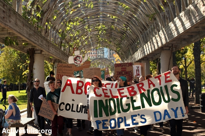 """Activists march in support of abolishing """"Columbus Day"""" and celebrate Indigenous Peoples' Day instead on October 11, 2015, Boston, Massachusetts. (photo: Tess Scheflan/Activestills.org)"""