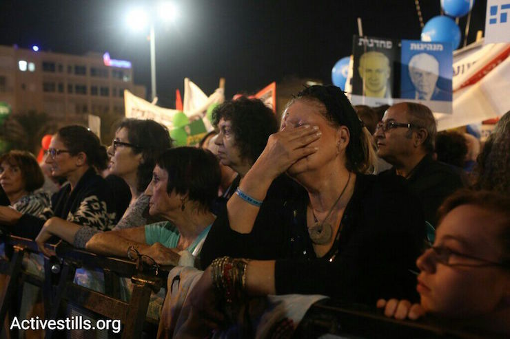 A woman cries at the Rabin memorial rally Rabin Square, Tel Aviv, October 31, 2015. (Oren Ziv/Activestills.org)