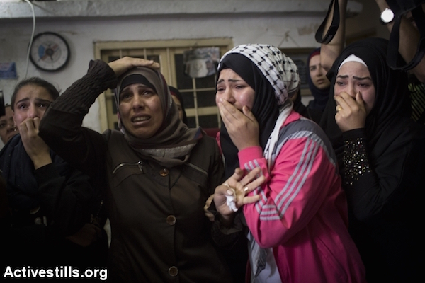 Relatives mourn during the funeral of 13-year-old Palestinian Ahmad Sharake, who was shot dead by Israeli soldiers during clashes near the Beit El settlement on October 12, 2015, in the Palestinian West Bank refugee camp of Jalazun, on the outskirts of Ramallah. Sharake was killed on October 11, during clashes that broke out as hundreds of Palestinians near Ramallah attempted to approach a road to throw stones and firebombs at settlers' cars. Jalazun, October 12, 2015. (Oren Ziv/Activestills)