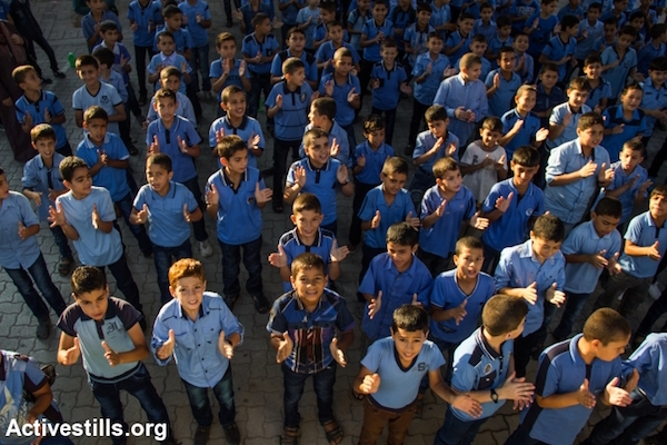 Palestinian boys line up during a morning assembly at a UNRWA school in Gaza City, Gaza Strip, September 15, 2014. (Anne Paq/Activestills.org)