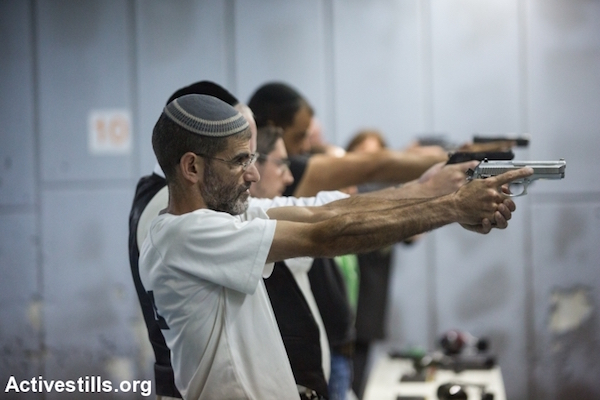 Illustrative photo of Israelis taking a shooting class in a Jerusalem gun shop, October 15, 2015. A number of Israeli leaders have called on citizens to arm themselves in response to a wave of Palestinian stabbing attacks, and the owner of this shop reported an increase in demand for personal weapons. (Yotam Ronen/Activestills.org)
