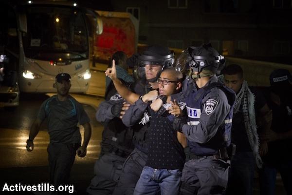 Israeli police arrest an Arab youth during a protest in Nazareth in northern Israel, October 8, 2015. (Omar Sameer/Activestills.org)