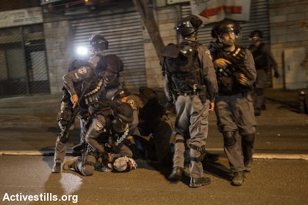 Israeli police arrest an Arab youth during a protest in Nazareth in northern Israel, October 8, 2015. (Faiz Abu Rmeleh/Activestills.org)