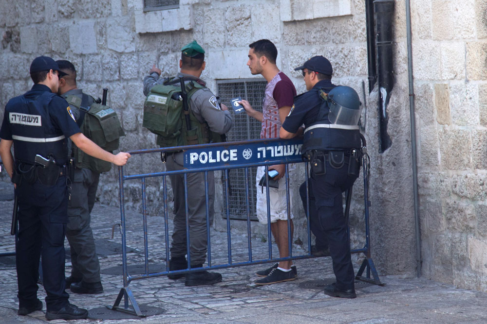 Police turn a man away at a checkpoint outside the Old City of Jerusalem, October 4, 2015. (Faiz Abu Rmeleh/Activestills.org) Israeli police banned most Palestinians from entering the Old City for a few days after a fatal stabbing attack.