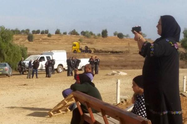 Residents of Al Araqib photograph and film as bulldozers flatten their homes, October 28, 2015. (Aziz Alturi)