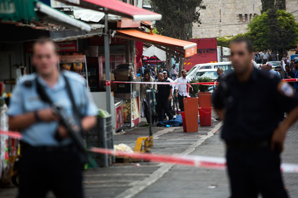 The scene of a stabbing attack near Damascus Gate in East Jerusalem, October 10, 2015. (Anne Paq/Activestills.org) The body is of the attacker, 16-year-old Ishaq Badran of Kufr Aqab in East Jerusalem, who was killed by police.