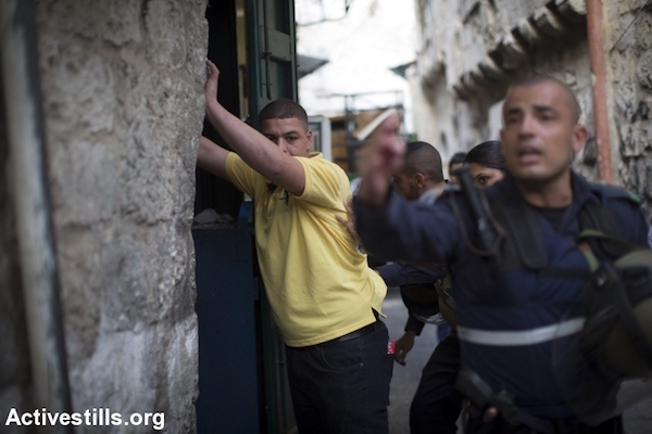 Israeli police detain and conduct a search on a Palestinian youth in Jerusalem's Old City, October 12, 2015. (Oren Ziv/Activestills.org)